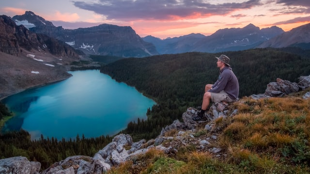 A man finding peace over a lake
