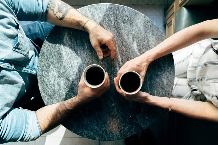 Two-people-talk-about-alternative-health-over-coffee