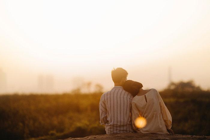 Couple Sitting on Stone