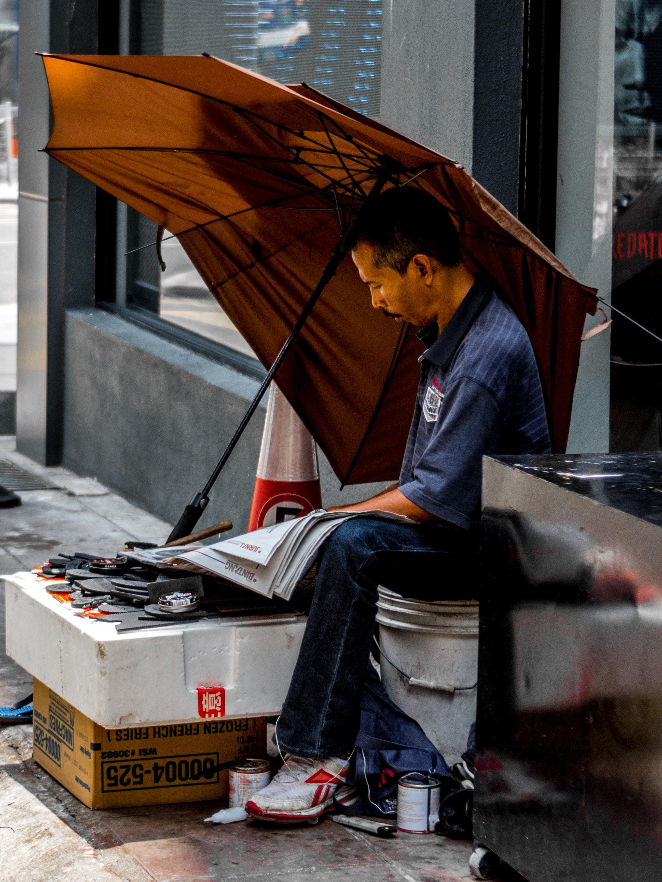 A street vendor reads the newspaper in Kuala Lumpur, Malaysia.