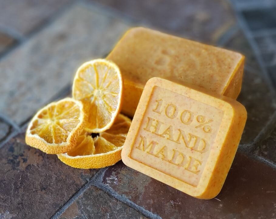 Dried orange slices next to hand made soap