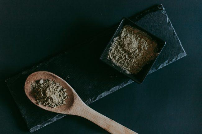 Kratom powder in a spoon