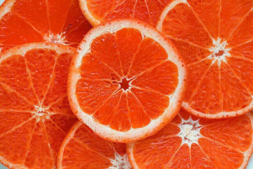 A close-up of slices of grapefruit